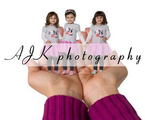 children in giant hands composite