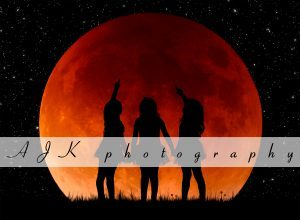 red moon silhouette composite
