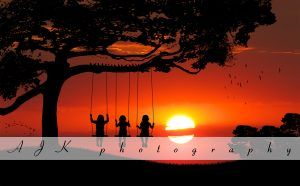 Girls on swing in sunset composite